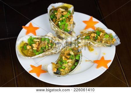Barbecue Geoduck With Onion And Grease. Asian Food