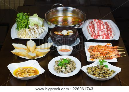 Set Of Vietnamese Seafood With Barbecue Tiger Shrimps, Grilled Sweet Snail, Bread Slide, Spicy Steam