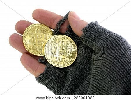 Concept Of The Risk Of Virtual Currency With Hand Of Poor Man Holding Bitcoin Coins On White Backgro