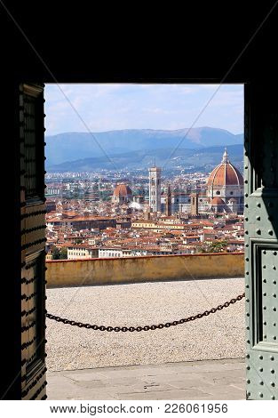 View Of Florence In Italy From An Open Gate Of A Church On The Hill