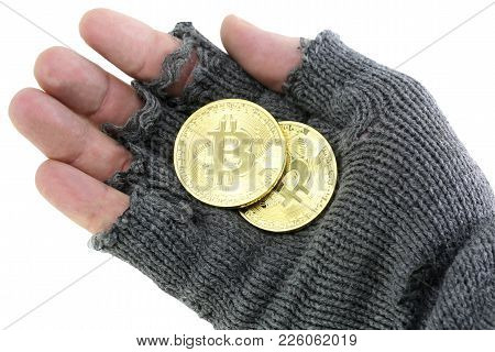 Bankrupt Concept: Hand Of The Poor With Broken Glove With Two Golden Bitcoin Coins