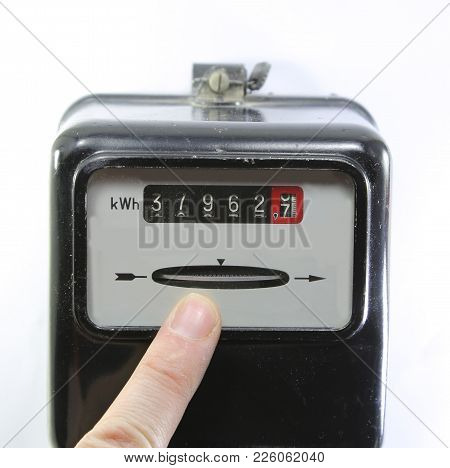 Index Finger Indicating The Consumption Of Electricity On A Electricity Meter On White Background