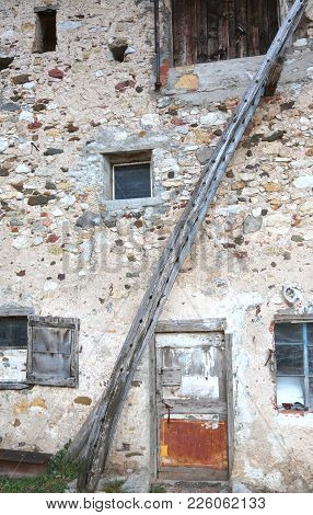 Ancient Long Wooden Ladder Of A Rural Farm