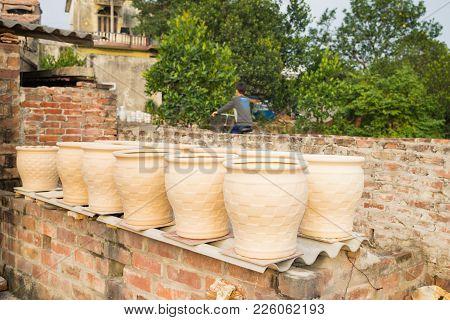 Processing Pottery Vase Drying In Bat Trang Ancient Ceramic Village. Bat Trang Village Is The Oldest