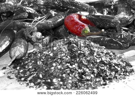 Crushed Red Pepperi And Hot Peppers In A Mixed Image Between Colors And Black And White