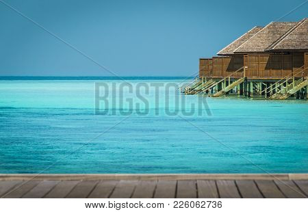 Beautiful Tropical Maldives Resort Hotel And Island With Beach And Sea On Sky For Holiday Vacation