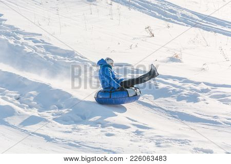 Children Ride On Tubing. Winter Entertainment. Skiing In The Winter. Snowy Fun In The Winter. Fun In