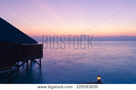 Private Villa From Maldives Tropical Resort At The Blue Hour. Suitable For An Idea Of Vacations, Car