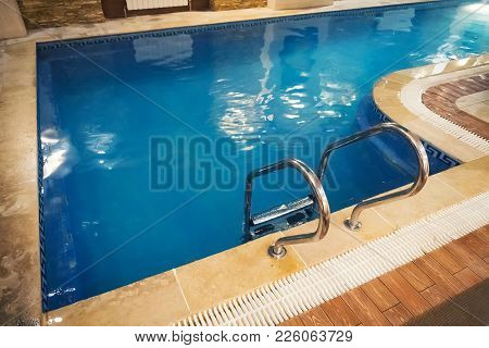 Indoor Swimming Pool With Stair In A Building
