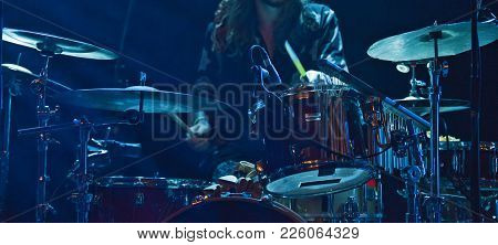 The Drummer Play On Stage. Rock Concert Scene.