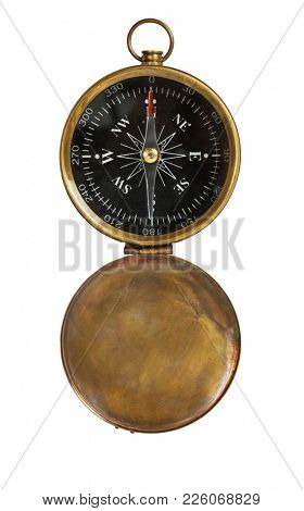 Old golden compass on white background showing north