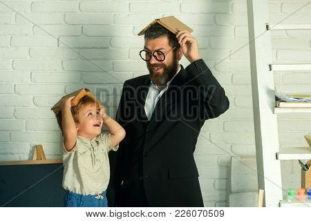 Funny Happy Education, Home Schooling With Father, Teacher With Schoolboy Reading Books Or Playing W