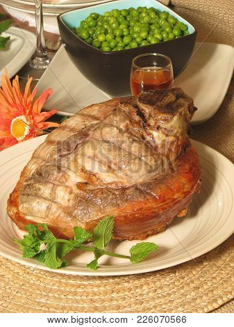 Traditional Sunday Dinner Meal, Oven Roasted Pork With Crispy Crackling, Served With Vegetables