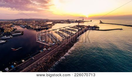 Aerial View Of The City Of Sete, France, With Port. Photo Taken At Sunrise.
