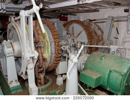 Winch Lifting Anchor Sailing Frigate. The Drive Mechanism Of The Anchor Chain