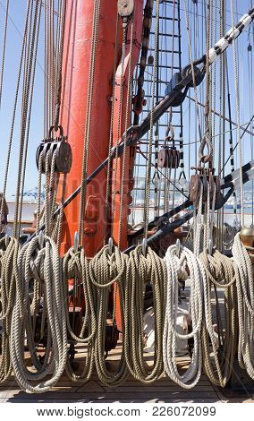 A Fragment Of A Rigging Of A Sailing Ship. The Mast Of A Sailing Frigate With Ropes