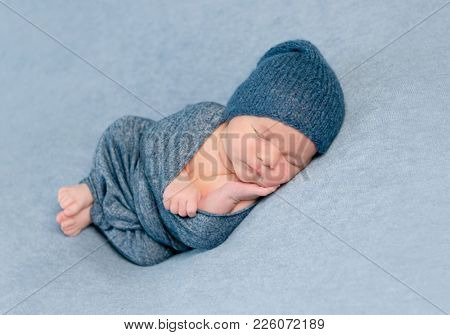 Newborn baby boy sleeps peacfully