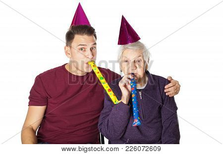 Picture Of Senior Disabled Woman With Grandson Celebrating Birthday On Isolated