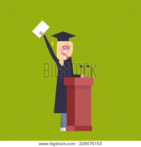 Happy Girl Student In Graduation Cap And Gown Standing At Tribune Hold Diploma On Green Background F