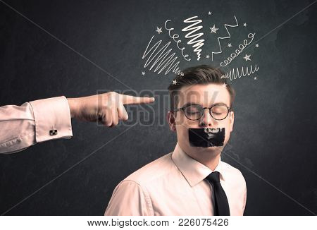 Caucasian business hand pointing at uncumprehended employee