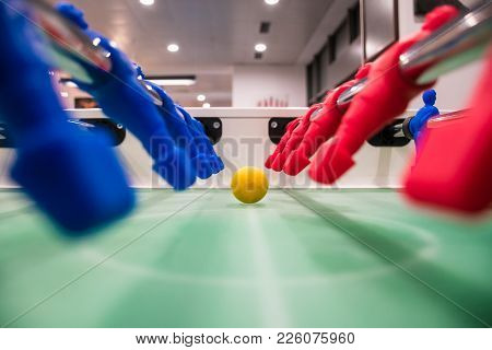 Close Up Of Foosball Table Soccer Game Match Figures. Football Kicker Game With Blue And Red Figurin