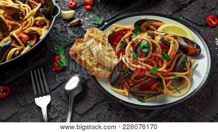 Homemade Pasta Spaghetti With Mussels, Tomato Sauce, Chilli And Parsley On Rustic Background. Sea Fo