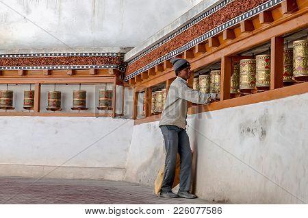 Leh, India - August 03, 2017: Happy Boy Turning The Tibetan Prayer Wheel Inside Chemday Monastery, L