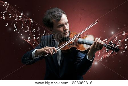 Lonely musical composer with violin and sparkling musical notes around