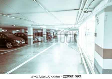 Blurred Image/ Parking Garage - Interior Shot Of Multi-story Car Park, Underground Parking With Cars