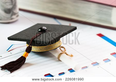 Graduate Study International Abroad Concept, Graduation Cap, Scroll Certificate Near On Documents Re