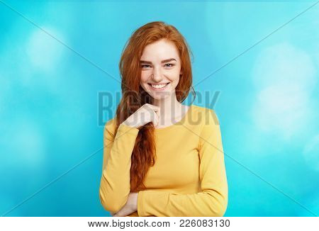 Lifestyle Concept - Close Up Portrait Young Beautiful Attractive Ginger Red Hair Girl Playing With H