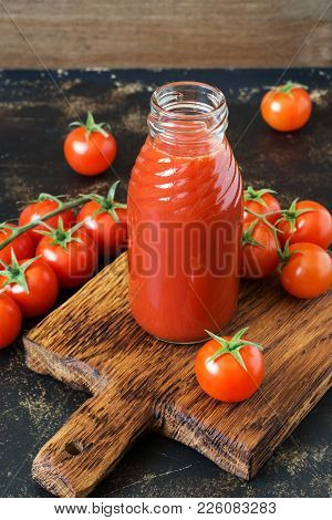 Fresh Tomato Juice In A Glass Bottle, Cherry Tomatoes
