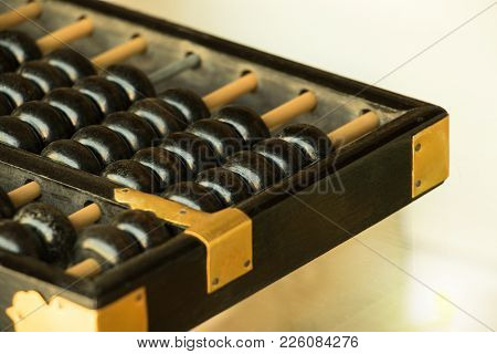 Close Up Of Old Vintage Retro Chinese Abacus On Wooden Table With Copy Space For Background. Vintage
