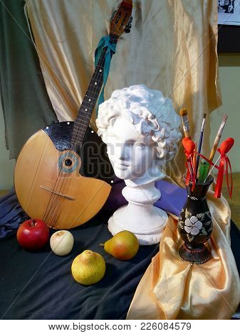 Still Life With A Gypsum Head Of Angel And A Musical Instrument