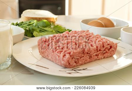 Food, Ingredients For Cooking Meat Cutlets, Minced Meat On A Plate, Onion, Chicken Eggs, Bread, Glas