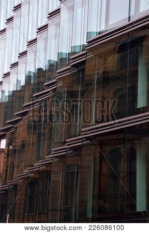 Reflection Of Houses In Glass Window Of Modern Building. Modern Office Building Exterior, Old Houses