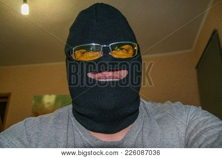 An Unknown Man In Mask