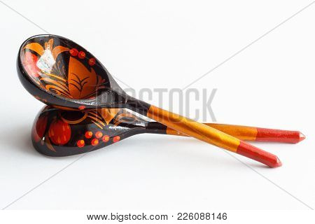 Wooden Spoons Decorated With Colored Inks. Wooden Spoons On White Background.