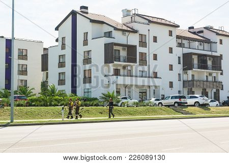 Russia, Sochi, Krasnodar Region-june 06.2017: Workers With Motorcycles Are On A Landscaped New Neigh