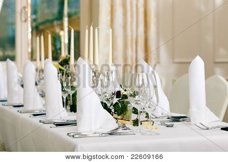 Wedding - feastfully decorated table with silverware and glasses