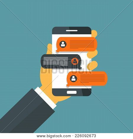 Hand Holding Smart Phone And Chatting Bubble Speeches. Mobile Phone With Chat Message Notifications.