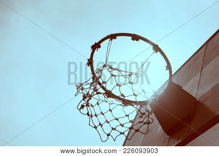 B&w Wooden Basketball Hoop During Sunset Background