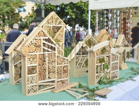Wooden Hotel For Insects Decorative House On A Market