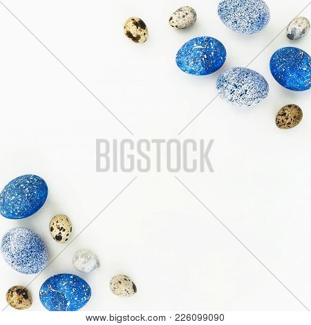 Easter Frame With Blue Speckled Easter Eggs And Quail Eggs With Copy Space On White Background. Flat