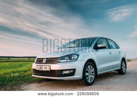Gomel, Belarus - May 27, 2017: Vw Volkswagen Polo Vento Sedan Car Parking In Field Near Country Road