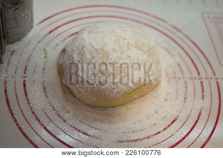 Close-up View Of The Homemade Raw Dough Ball Lying On The Modern Cooking Surface. Dough For Pizza, P