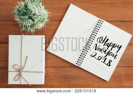 Wooden Work Space - Flat Lay View Photo Of Working Desk With Happy New Year Wish Notebook And A Gift