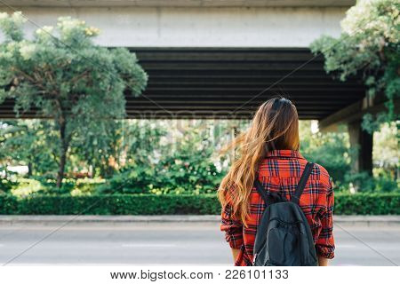 Young Asian Women Standing Along The Street Enjoying Her City Lifestyle In A Morning Of A Weekend Wa