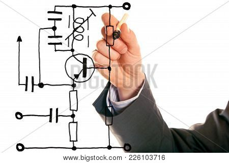 Studio Shot Of Engineer Designing A Simple Electric Circuit