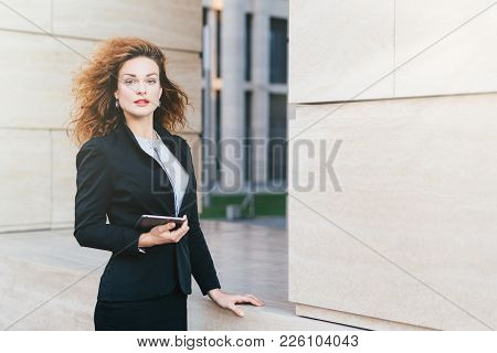 Businesswoman Wearing Formal Clothes, Holding Modern Gadget Which She Uses For Reading Messages, E-m